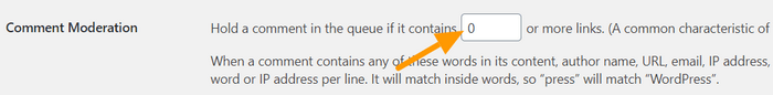 Go to Settings - Discussion - Comment Moderation section and set the number of allowed links.